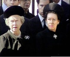 Princess Diana's funeral - Queen Elizabeth II and Princess Margaret (with her son David, Viscount Linley behind her) stand at the gate of Buckingham Palace with the rest of the Royal Family waiting for the coffin of Princess Diana to come by on it's way to Westminster Abbey. A historical moment occurred when the Queen bent her head as the coffin went by.