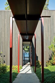 The steel canopy protects the residents from Seattle's notoriously rainy weather as they walk from the entry gate to the front door.