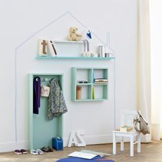 Shelves and coat in a child's room of a house painted wall