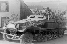 A SdKfz 251/1 halftrack operating on a city street