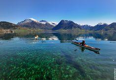 Kayaking at the Hardangerfjord, near Rosendal. Norway. 5-5