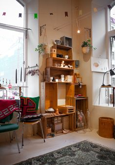 Wooden Crates stacked to create shelving unit / Fine Little Day