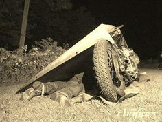 Motorcycle camping - all you need is a tarp and a blanket.