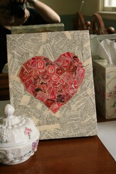 Postage Stamp Art 2: Canvas + dictionary pages + red stamps  + mod podge = very cute piece of art!