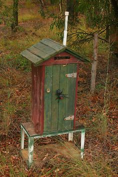 It's an outhouse mailbox! 'There was a red back on the toilet seat when I was there last night....' A very Aussie letterbox.