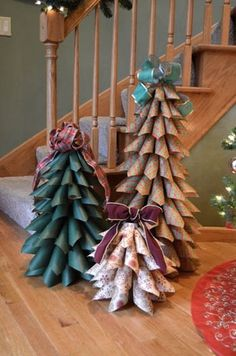 Styrofoam cone.  Heat and bond two fabrics together, cut into squares.  Larger at the bottom to smaller on the top.  Roll into cone and pin top corner into styrofoam to create the tree.  Top with a cool bow.
