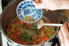 To make Moro de Guandules, a traditional Dominican Pigeon Peas Rice dish, you'll start by sauteeing garlic, onion, red pepper, carrots and celery and then adding your dry herbs