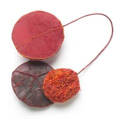 """Myung Urso  Season Brooch in silk, thread, sterling silver and lacquer. Approx. 5 1/2 x 4 3/4""""."""
