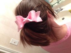 Made a vintage-style bow out of felt and pinned it using a bobby pin. Could make a headband out of it or use an alligator clip.