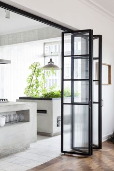 Black framed glass bifold doors.