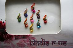 9 Handcrafted Indian Bindis for Face & Eyebrow Makeup.