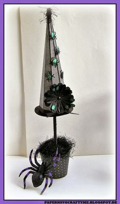 The Witch Hat Topiary from CATACOMB MANOR SVG KIT is a perfect centerpiece for your Halloween table!  Elke spiced hers up with glitter cardstock, some fluffy wool and stickles!  What a spectacular trio!  Even her spiders are colorful!  Can't forget them!  Fabulous!