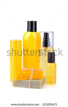 Handmade herbal soaps and lotions in orange bottles on white background - stock photo