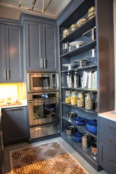 pantry - will need wall ovens and warmer to supplement the la cornue. like open shelving, love the color, lighting, hardware sheen on cabinetry