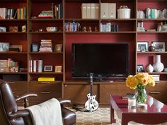 Once considered an eyesore, flat-screen TVs are now a focal point in contemporary living rooms. But how do you stylishly hide all those unsightly wires and accessories? See how top designers put TVs on display without sacrificing style.