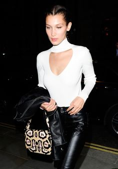 Bella Hadid takes her choker game next level in a keyhole cut-out choker top, plus leather trousers and Givenchy handbag