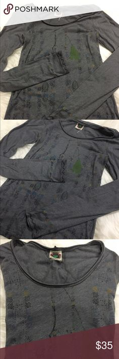 """Free People Henley Soft and broken in Free People henley.   Grey with a cute design on the front and the bottom of the sleeves.   No flaws, rips, or tears!   21"""" sleeves, 14"""" bust, 24"""" length (approximate).  Throw this on with your favorite pair of lounge pants and you're all set for binge watching This Is Us.  Spoiler alert.  Get tissue.  A lot of it.  And wear waterproof mascara.   I wept like a baby. Free People Tops Tees - Long Sleeve"""