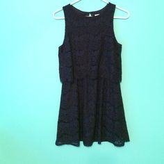 Dark navy mini dress Cute little dark blue dress, with sweet and soft flowery lace all over the dress. The top hangs over the bottom. Key hole loop just under the neck. Brand new, still has tags, never worn. Monteau Dresses Mini