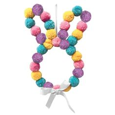 Get into the Easter spirit with our Hanging Pom-Pom Bunny. This fun decoration features colorful pom-poms in the shape of a bunny and a lilac bow. Use the included ribbon to hang this bow outside on your front door or inside on a wall. Crafts For Teens To Make, Easter Crafts For Kids, Crafts To Sell, Easy Crafts, Diy And Crafts, Easter Ideas, Easter Projects, Kid Crafts, Art Projects