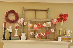 vintage inspired Valentines decorations, cherubs on pillars, white pitcher, amaryllis