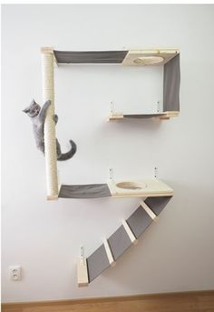 Cat climbing wall A puppy, or companion animal, is an animal kept primarily for a Cat Climbing Wall, Cat Gym, Cat Jungle Gym, Diy Cat Tree, Cat Playground, Playground Ideas, Cat Towers, Cat Shelves, Pet Furniture