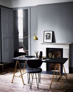 A brass and black lamp fits a mid century modern manly office