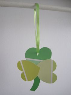 """St. Patrick's Day Craft for Kids: Hanging Paint Swatch Shamrock - Lara Smith"""