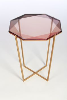 Our Gem collection of tables are inspired by the reflections of light and transparencies found in gemstones. These metal and glass tables translate facets through layers of color and varying opacity.