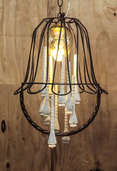 Hanging LightBasket LightRustic LightingRustic by Llewminate Love how they used a metal basket for the lamp shade on this chandelier!