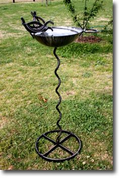 Perfect as garden sculpture - functional bird feeder made from horse shoes and recycled metal wheel & parts