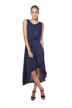 Soft, tank jersey dress with assymetrical hem and scoop back neckline. Features a tie at the waist. 100% Viscose.