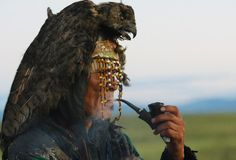 A shaman awaits the sunrise during the grand shamanic ritual upon the 9th anniversary of the Bear Spirit Association and the 90th anniversary of the Tuva Republic.
