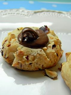 Nutella Thumbprint Cookies  http://bakersdaughter.typepad.com/the_bakers_daughter/2010/06/nutella-thumbprint-cookies.html#