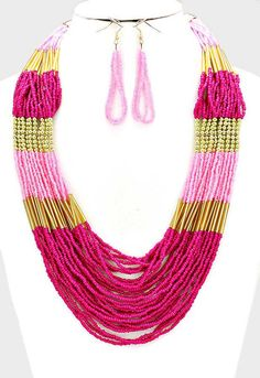 Boho Pink Seed Multi Strand Necklace Bright and fun, boho style seed bead necklace. Pink, fuchsia, and gold beads in a multi layered statement necklace. Meas