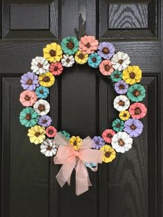 What a beautiful way to decorate your door for spring. This wreath is handmade out of Pinecones. Pinecones are cut into flower shape and hand painted in Vintage Pastel Spring colors. Base is, 12in however finished wreath is about 17in. Bow is tied on and can be easily adjusted if you prefer bow placed in a different position on the wreath.