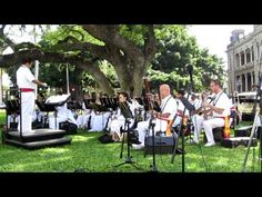 """In-concert on the grounds of 'Iolani Palace, The Royal Hawaiian Band performs """"The Queen's Hula."""" The RHB, an agency of the City & County of Honolulu, was founded in 1836 by King Kamehameha III, and is the only band in the United States with a royal legacy. With cultural roots dating back to the time of the Hawaiian monarchy, The RHB has served the people of of Hawaii for over 175 years..."""