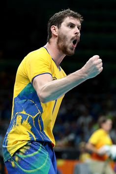Bruno Rezende of Brazil reacts to defeating Brazil during the Men's Quarterfinal…