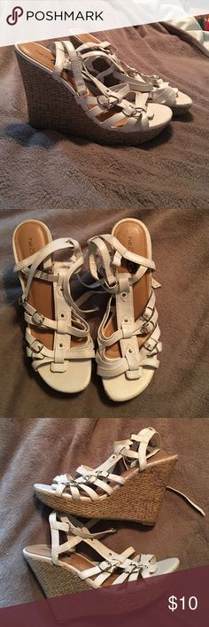Strappy wedged sandals White strappy wedged sandals, lightly worn. I can model them so you will have a better idea of how the look being worn. Rue 21 Shoes Wedges