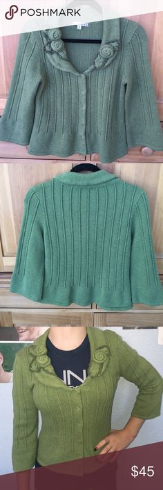 CAbi sweater/cardigan CAbi sweater/cardigan is in excellent condition all snaps are intact, NO imperfections. Cole is most accurate on the model. It is a limey blueish green. Size Small! CAbi Sweaters Cardigans