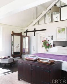 Like the windows above bedroom that separate bedroom and bathroom