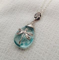 This delicate necklace is made of 18x25mm aquamarine glass teardrop, 14mm ox silver plated brass dragonfly, silver bail, silver plated chain and