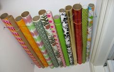 Use wire to make a space against the ceiling of a closet to store wrapping paper rather than have the rolls take up space on the floor.