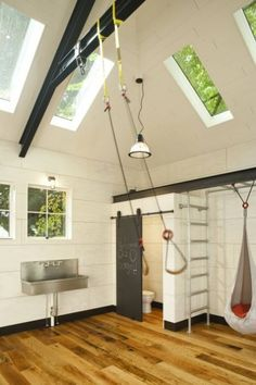 "traditional garage and shed by Menter Architects LLC - converted to a family activity room.  But, what I really like are the skylights =)"" Bathroom....very cool!"