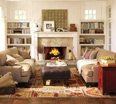 Cozy living room - like the stone on the fireplace and book cases