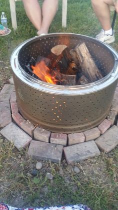 Dryer drum fire pit drill holes . Put part in the ground.
