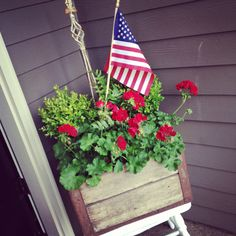 Old Milk Crate with flowers! Fun for a 4th of July front porch display!