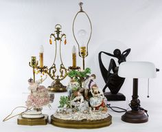 Lot 139: Electric Table Lamp Assortment; Five items items including (2) unmarked ceramic figural lamps, an Art Deco reproduction metal dancer lamp, a two light candelabra style lamp and a contemporary desk lamp
