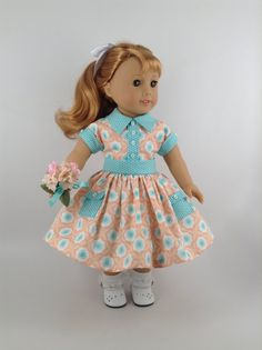 Handmade Dress and Petticoat for American Girl and other similar 18-inch dolls.  Maryellen is wearing her new cotton dress in colors of peach,