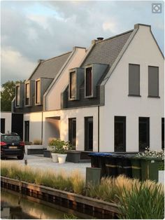 Modern take on a traditional house. Garden Architecture, Residential Architecture, Contemporary Architecture, Architecture Details, Alcacer Do Sal, Mansard Roof, Arch House, Dormer Windows, Terraced House