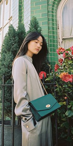 Large Darley Bag in Ocean Green and the Pippa Jumpsuit in Light Grey at Mulberry.com.